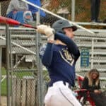Justin Bosland completing his swing after hitting a long home run