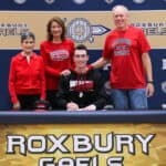 Justin Bosland with his parents Joyce and Bruce and his Grandmother Laura on National Signing Day 2020