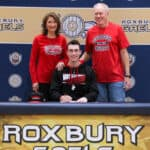 Justin Bosland with his parents Joyce and Bruce on National Signing Day 2020